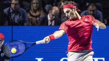 The maestro: Roger Federer of Switzerland returns a ball to Stefanos Tsitsipas of Greece.