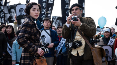 Johnny Depp as the American photographer W. Eugene Smith and  Japanese actress Minami as Aileen.