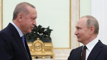 Russian President Vladimir Putin, right, and Turkish President Recep Tayyip Erdogan meet in the Kremlin.