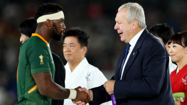 Bill Beaumont, right, won a second term as World Rugby chairman on the promise of delivering the change he failed to deliver in his first term.