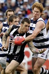 Cats tagger Cameron Ling puts Magpies midfielder Dane Swan under pressure.