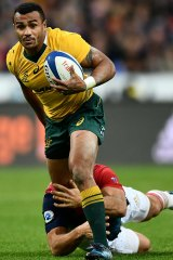 Will Genia makes a break past Maxime Machenaud of France during a Test in 2016.
