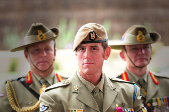 Ben Roberts-Smith, middle, after receiving his Victoria Cross in 2011.