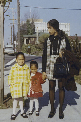 Kamala Harris in 1970 with sister Maya (centre) and mum Shyamala, who separated from her father, Donald, when Harris was five.