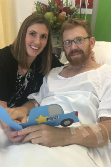 Sergeant Warburton, pictured with his wife, has had 14 surgeries since he was shot.