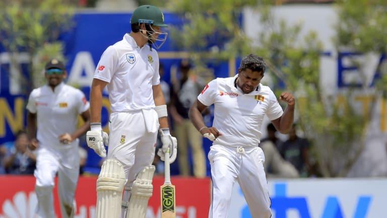 Victory dance: Rangana Herath dismisses South Africa's captain Faf du Plessis.