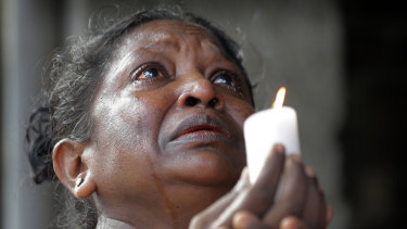 A woman prays in tears during three minutes of silence on Tuesday morning.