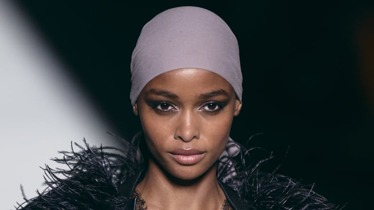A model wearing a head scarf, one of the signature looks at the Tom Ford show.