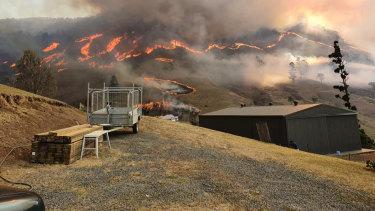 A bushfire burning in the Gold Coast hinterland on Friday.