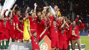 Inaugural: Cristiano Ronaldo holds aloft the Nations League trophy.