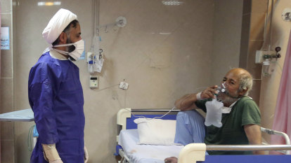 Iran reports more than 100 new virus deaths as fears mount