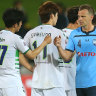 Sydney FC skipper Alex Wilkinson bumps fists with Lee Soobin of Jeonbuk Hyundai Motors before Wednesday night's AFC Champions League clash. The greeting was agreed by both clubs in lieu of the usual handshakes.