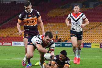 Angus Crichton goes over for one of the Roosters' 10 tries against the Broncos on Thursday night.