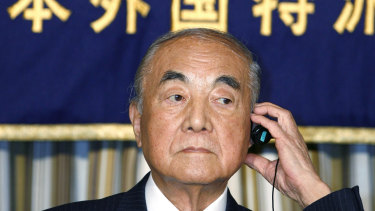 Japanese Prime Minister Yasuhiro Nakasone adjusts earphone during a press conference in Tokyo in 2007.