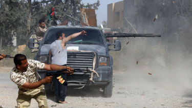 Libyan fighters loyal to the Government of National Accord (GNA)  fire their guns during clashes with forces loyal to strongman Khalifa Haftar south of Tripoli.