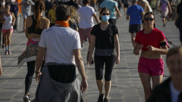 Runners on a seafront promenade in Barcelona on the first weekend the lockdown was eased for exercise.