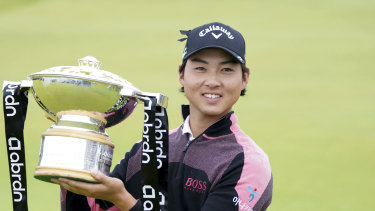 Australia's Min Woo Lee holds the trophy after winning the Scottish Open at The Renaissance Club.