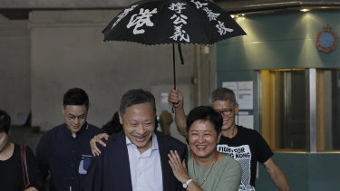 Occupy Central leader Benny Tai, front left, is accompanied by pro-democracy lawmaker Helena Wong, family members and supporters as he leaves the High Court on Thursday.