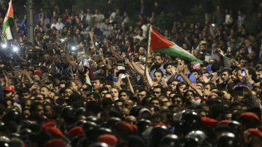Thousands of protesters face off with police  outside Prime Minister  Hani Mulki office in the capital Amman.