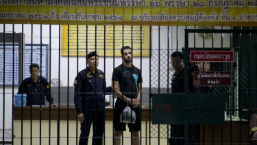 Hakeem al-Araibi waits to transferred to a jail in a court house in Bangkok. It's been revealed that it was Australia that tipped off Thai authorities to his arrival.