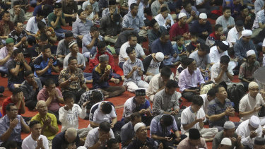 People gather for Friday prayers at the Istiqlal Mosque in Jakarta, Indonesia, on February 14.
