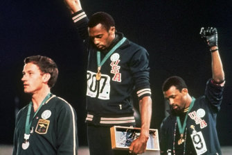 US athletes Tommie Smith and John Carlos, with Australia's Peter Norman, in their famous pose at the 1968 Games in Mexico.