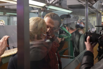 In this photo taken from video, Alexei Navalny kisses his wife Yulia as he is detained by police at the passport control after arriving at Sheremetyevo airport, outside Moscow, Russia.