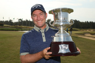 Josh Younger with the Kel Nagle Trophy after winning the NSW Open yesterday.