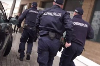Police are pictured storming into the Belgrade hotel moments before the dramatic arrests.