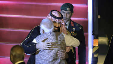 Saudi Crown Prince Mohammed bin Salman is hugged enthusiastically by Indian PM Narendra Modi at the airport in Delhi.