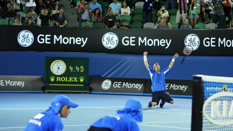 Lleyton Hewitt celebrates victory over Marcus Baghdatis after close to five hours on court in 2008.