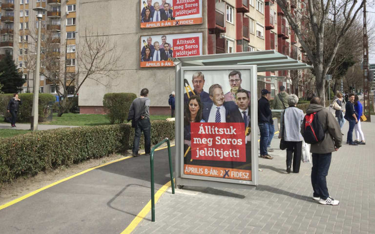 "A billboard from Prime Minister Viktor Orban's Fidesz party reads ""Let's stop Soros' candidates!"""