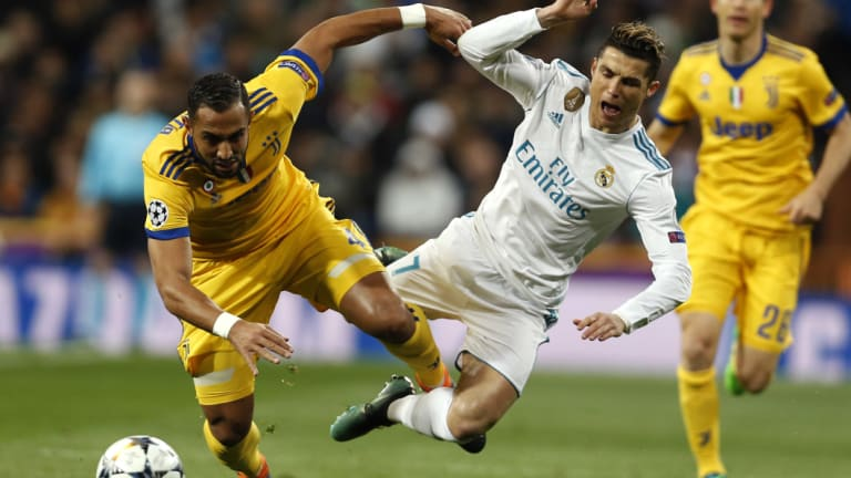 He\'ll soon wear yellow too: Real Madrid\'s Cristiano Ronaldo as he was tackled by Juventus\' Medhi Benatia during a Champions League match in April.