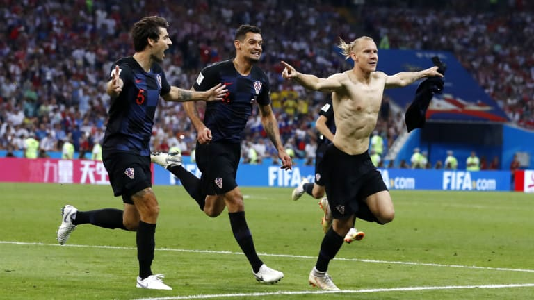 Look at my abs:  Croatia's Domagoj Vida earned himself a yellow card for removing his shirt.