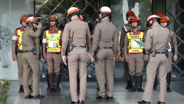 Traffic police gather outside the venue hosting the ASEAN meeting in Bangkok.