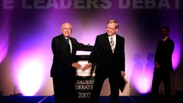 John Howard and Kevin Rudd shake hands ahead of the 2007 debate.