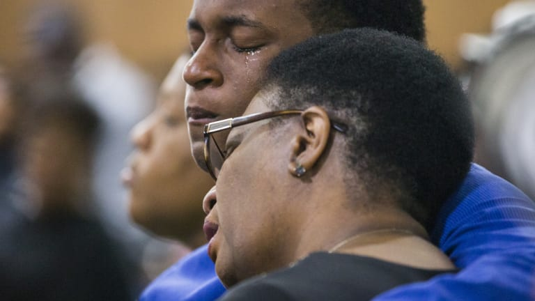 Allison Jean and her son Grant, 15, mourn Botham Jean, Allison's son and Grant's brother during a prayer service for Jean at the Dallas West Church of Christ on Sunday.