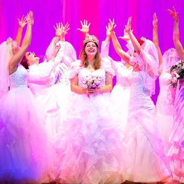 Natalie Abbott (centre) stars as Muriel Heslop in Muriel's Wedding The Musical.