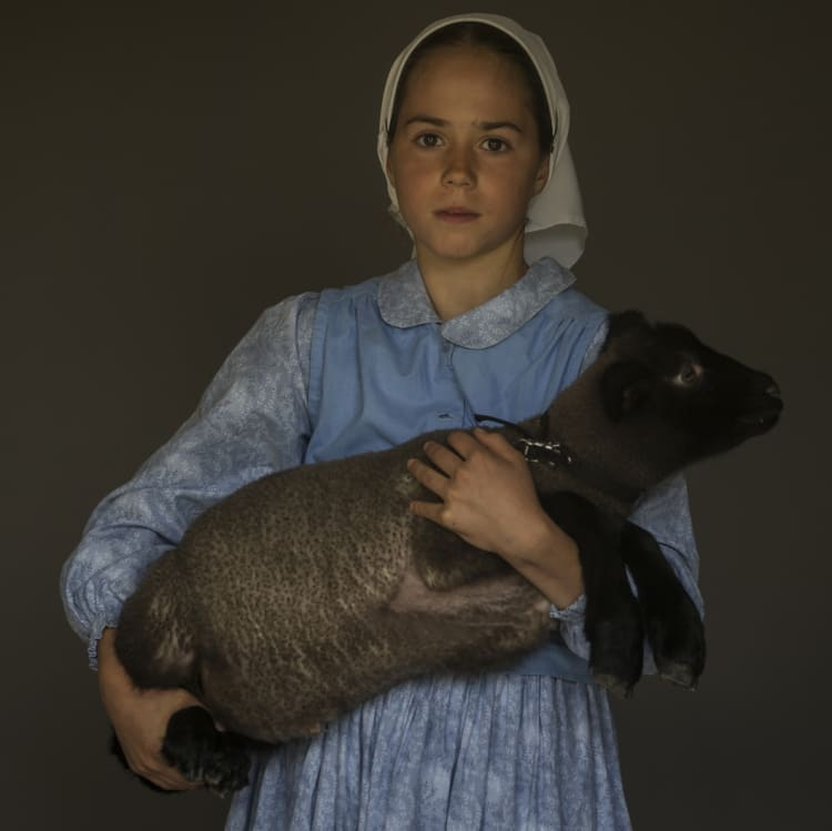 Mary, 10, with her pet lamb Domino.