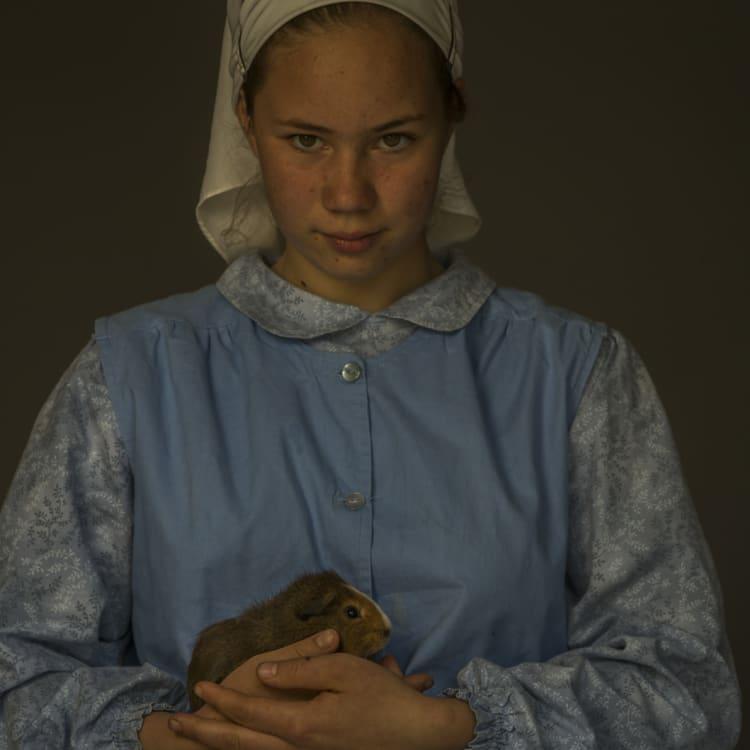 Elizabeth, 12, holds her pet guinea pig.