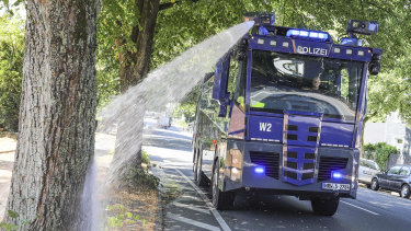 German police find a new use for their water cannons amid record-breaking heat in that country on Wednesday. Those heat records, though, may last just one day.