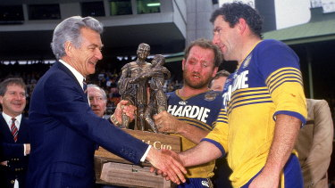 Mick Cronin and Ray Price accept the Winfield Cup from Prime Minister Bob Hawke in 1986.