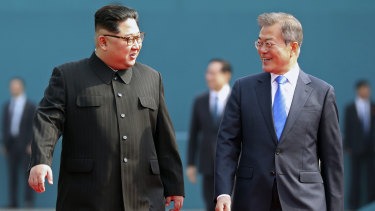 North Korean leader Kim Jong-un, left, talks with South Korean President Moon Jae-in, right, after the welcoming ceremony at the border village of Panmunjom.