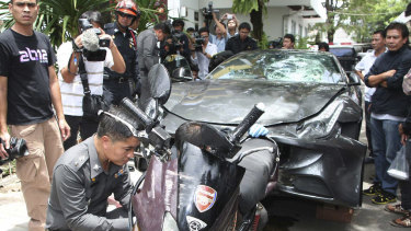 A Ferrari that was driven by Vorayuth Yoovidhya and a motorcycle, both involved in the accident, are displayed by police in Bangkok in 2012.