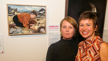 Megan Nicolson (left) with a portrait of Colleen Hughson (right) titled <i>Good Will Nurdle Hunter</i>.