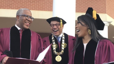 Robert F. Smith, left, laughs with David Thomas, centre, and actress Angela Bassett at Morehouse College.