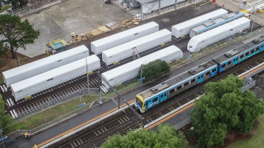 Carriages next to North Williamstown railway station, from the $5.2 billion train order made by the Andrews government. They have been shipped from China and are awaiting assemblage.