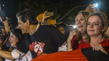 Fernando Haddad, former mayor of Sao Paulo, third right, and Senator Gleisi Hoffman, president of the Workers' Party (PT), right, join demonstrators during a rally against local government officials and in support of Lula.