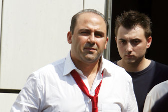 Tony Mokbel is escorted out of an Athens court by police in 2007.