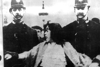 Feminist Christabel Pankhurst is led away by a London policeman.